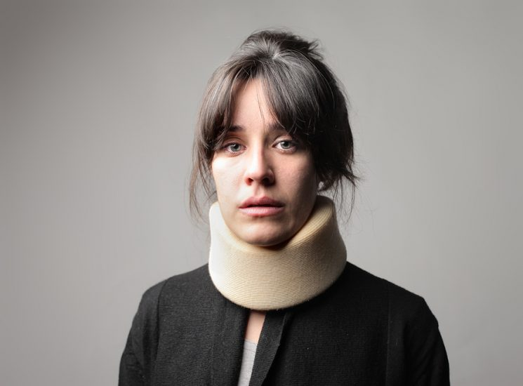 Woman wearing a neck brace